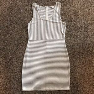 Bodycon style black and off white striped dress.